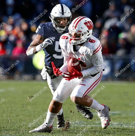 Wisconsin's Danny Davis (6) makes a catch in front of Penn State's Tariq Castro-Fields (5) during the second half of an NCAA college football game in State College, Pa., . Penn State won 22-10