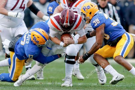 Stock Image of Ryan Willis, Rashad Weaver, Cam Bright. Virginia Tech quarterback Ryan Willis (5) is sacked by Pittsburgh defensive lineman Rashad Weaver (17) and linebacker Cam Bright (38) in the first quarter of an NCAA football game, in Pittsburgh
