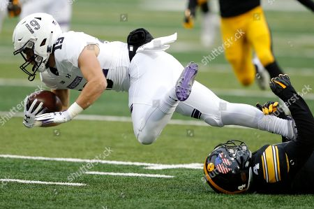 Riley Lees, Josh Turner. Northwestern wide receiver Riley Lees, left, is tackled by Iowa's Josh Turner, right, while returning a punt during the first half of an NCAA college football game, in Iowa City, Iowa
