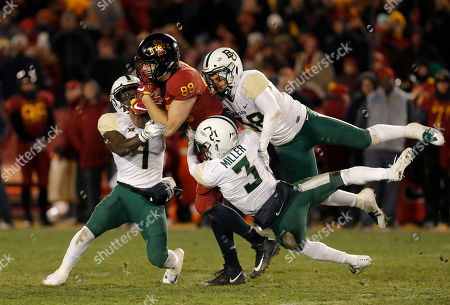 Iowa State tight end Charlie Kolar, center, is brought down by Baylor's Verkedric Vaughns, left, Chris Miller and Jordan Williams, right, during the second half of an NCAA college football game, in Ames, Iowa. Iowa State won 28-14