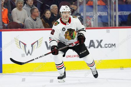 Chicago Blackhawks' Luke Johnson looks on during the third period of an NHL hockey game against the Philadelphia Flyers, in Philadelphia. The Flyers won 4-0