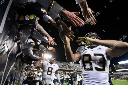 Georgia Tech wide receiver Brad Stewart (83) and quarterback Tobias Oliver (8) celebrate with fans after an NCAA college football game against Miami, in Atlanta. Georgia Tech won 27-21