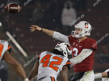 Stanford quarterback K.J. Costello (3) throws a pass under pressure by Oregon State linebacker Doug Taumoelau (42) in the second half during an NCAA college football game, in Stanford, Calif. Stanford won 48-17