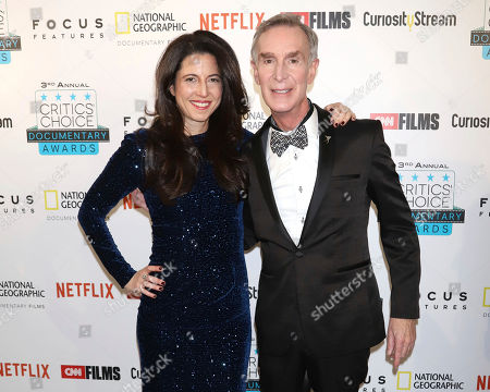 Stock Image of Heather Berlin, Bill Nye. Heather Berlin, left, and Bill Nye attend the third annual Critics' Choice Documentary Awards at BRIC, in New York