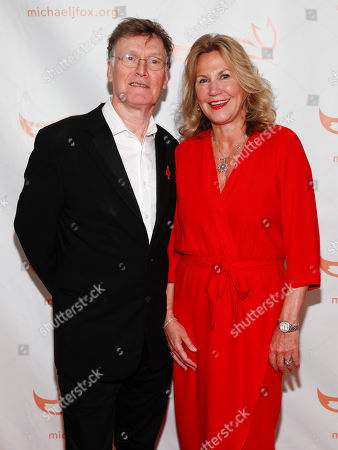 Stock Picture of Steve Winwood, Eugenia Winwood. Steve Winwood, left, and Eugenia Winwood, right, attend the Michael J. Fox Foundation 2018 benefit gala at the New York Hilton Midtown, in New York