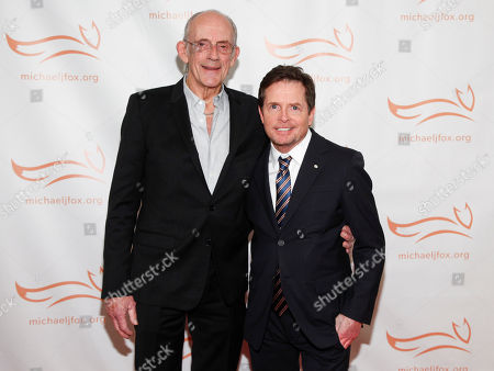 Christopher Lloyd, Michael J. Fox. Christopher Lloyd, left, and Michael J. Fox, attend the Michael J. Fox Foundation 2018 benefit gala at the New York Hilton Midtown, in New York