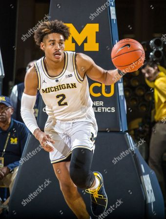 1431a02f27c Michigan guard Jordan Poole (2) dribbles with the ball in the second half of
