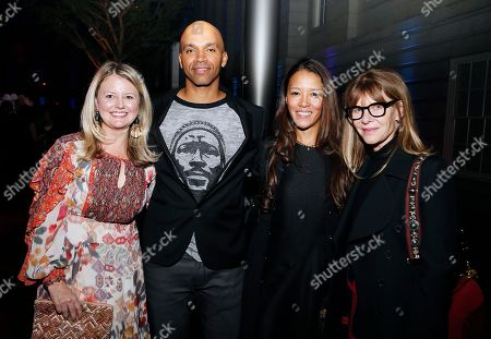 """Left to right, Curator Dorothy Moss, artist Kadir Nelson, Jungmiwha Bullock and Kate Capshaw attend the """"Face Forward Artist Party"""" at the Smithsonian's National Portrait Gallery, in Washington"""