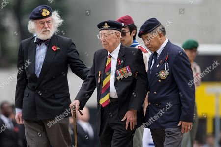 Hong Kong Veterans Walk After Laying Wreaths In Front Of The Cenotaph In Hong Kong
