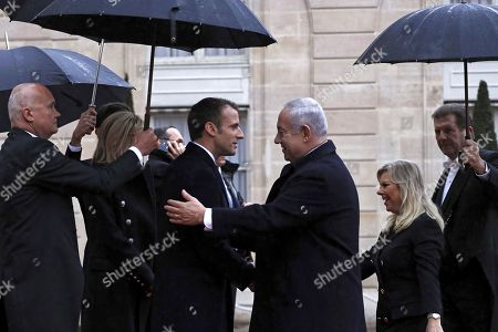 French President Emmanuel Macron (L) welcomes Israeli Prime Minister Benyamin Netanyahu (R) at the Elysee Palace ahead of the international ceremony for the Centenary of the WWI Armistice of 11 November 1918, in Paris, France, 11 November 2018. World leaders have gathered in France to  mark the 100th anniversary of the First World War Armistice with services taking place across the world to commemorate the occasion.