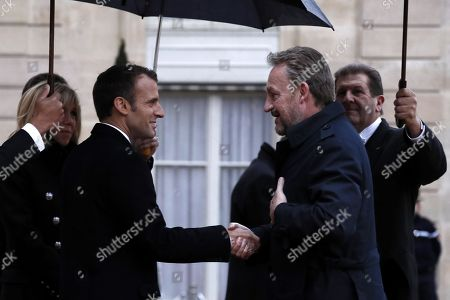 French President Emmanuel Macron (L) welcomes Bosnia and Herzegovina's Chairman of the Presidency Bakir Izetbegovic (R) at the Elysee Palace ahead of the international ceremony for the Centenary of the WWI Armistice of 11 November 1918, in Paris, France, 11 November 2018. World leaders have gathered in France to mark the 100th anniversary of the First World War Armistice with services taking place across the world to commemorate the occasion.