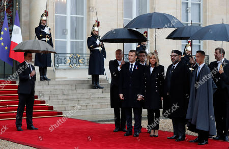 Morocco's King Mohammed VI (CR)and his son Crown Prince Moulay Hassan (R) welcomed by French President Emmanuel Macron (L) and his wife Brigitte Macron (CL) at the Elysee Palace ahead of the international ceremony for the Centenary of the WWI Armistice of 11 November 1918, in Paris, France, 11 November 2018. World leaders have gathered in France to mark the 100th anniversary of the First World War Armistice with services taking place across the world to commemorate the occasion.