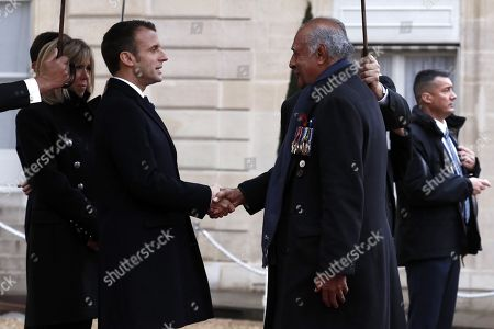 Stock Picture of French President Emmanuel Macron (L) welcomes President of the Republic of Fiji Jioji Konousi Konrote (R) at the Elysee Palace ahead of the international ceremony for the Centenary of the WWI Armistice of 11 November 1918, in Paris, France, 11 November 2018. World leaders have gathered in France to mark the 100th anniversary of the First World War Armistice with services taking place across the world to commemorate the occasion.