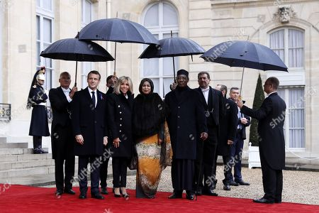 Chad's President Idriss Deby Itno (3-R) is welcomed by French President Emmanuel Macron (2-L) at the Elysee Palace ahead of the international ceremony for the Centenary of the WWI Armistice of 11 November 1918, in Paris, France, 11 November 2018. World leaders have gathered in France to mark the 100th anniversary of the First World War Armistice with services taking place across the world to commemorate the occasion.