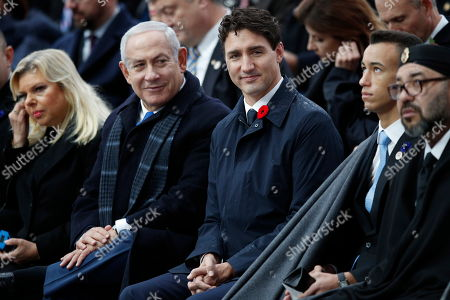 Israeli Prime Minister Benjamin Netanyahu (2-L), his wife Sara Netanyahu (L), Canadian Prime Minister Justin Trudeau (C), Moroccan King Mohammed VI (R) and Crown Prince Moulay Hassan (2-R) attend the international ceremony for the Centenary of the WWI Armistice of 11 November 1918 at the Arc de Triomphe, in Paris, France, 11 November 2018. Heads of State and Government commemorate their fallen soldiers in France.