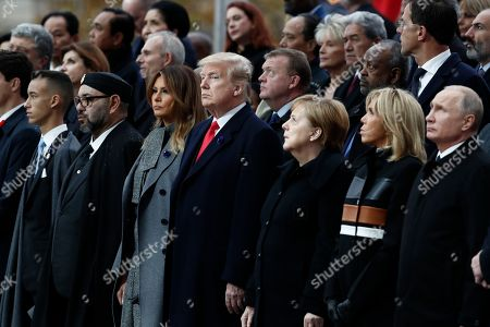 (L-R) Moroccan Crown Prince Moulay Hassan, Moroccan King Mohammed VI, US first lady Melania Trump, US President Donald J. Trump, German Chancellor Angela Merkel, French First Lady Brigitte Macron and Russian President Vladimir Putin attend the international ceremony for the Centenary of the WWI Armistice of 11 November 1918 at the Arc de Triomphe, in Paris, France, 11 November 2018. Heads of State and Government commemorate their fallen soldiers in France.
