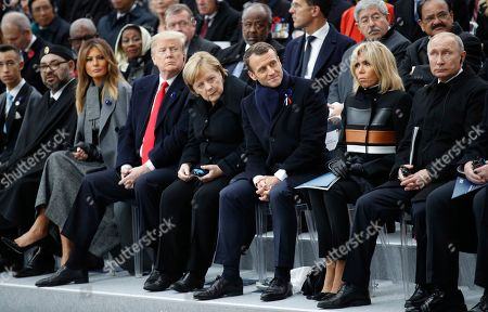 (L-R) Moroccan Crown Prince Moulay Hassan, Moroccan King Mohammed VI, US first lady Melania Trump, US President Donald J. Trump, German Chancellor Angela Merkel, French President Emmanuel Macron, French First Lady Brigitte Macron and Russian President Vladimir Putin attend the international ceremony for the Centenary of the WWI Armistice of 11 November 1918 at the Arc de Triomphe, in Paris, France, 11 November 2018. Heads of State and Government commemorate their fallen soldiers in France.