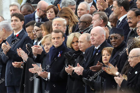 (L-R) Canadian Prime Minister Justin Trudeau, Morocco's Prince Moulay Hassan, Moroccan King Mohammed VI, US First Lady Melania Trump, US President Donald J. Trump, German Chancellor Angela Merkel, French President Emmanuel Macron and his wife Brigitte Macron, Russian President Vladimir Putin, Australian Governor-General Peter Cosgrove and his wife Lynne Cosgrove, Tchad's President Idriss Deby and his wife Hinda Deby Itno and Tunisia's President Beji Caid Essebsi applaud during the international ceremony for the Centenary of the WWI Armistice of 11 November 1918 at the Arc de Triomphe, in Paris, France, 11 November 2018. World leaders have gathered in France to mark the 100th anniversary of the First World War Armistice with services taking place across the world to commemorate the occasion.