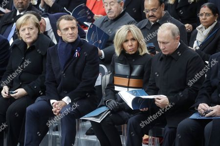 (L-R) Moroccan Crown Prince Moulay Hassan, Moroccan King Mohammed VI, US first lady Melania Trump, US President Donald J. Trump, German Chancellor Angela Merkel, French First Lady Brigitte Macron and Russian President Vladimir Putin  attend the international ceremony for the Centenary of the WWI Armistice of 11 November 1918 at the Arc de Triomphe, in Paris, France, 11 November 2018. World leaders have gathered in France to mark the 100th anniversary of the First World War Armistice with services taking place across the world to commemorate the occasion.