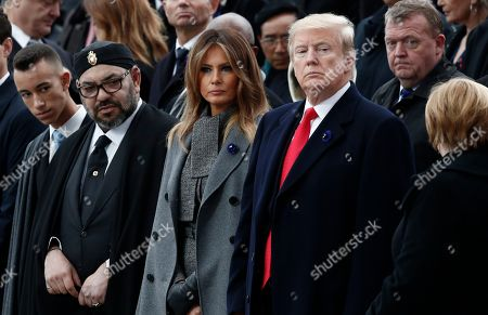 (L-R) Moroccan Crown Prince Moulay Hassan, Moroccan King Mohammed VI, US first lady Melania Trump, US President Donald J. Trump and German Chancellor Angela Merkel attend the international ceremony for the Centenary of the WWI Armistice of 11 November 1918 at the Arc de Triomphe, in Paris, France, 11 November 2018. Heads of State and Government commemorate their fallen soldiers in France.