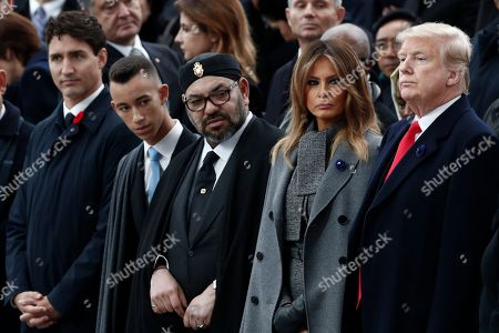 (L-R) Canadian Prime Minister Justin Trudeau, Moroccan Crown Prince Moulay Hassan, Moroccan King Mohammed VI, US first lady Melania Trump and US President Donald J. Trump attend the international ceremony for the Centenary of the WWI Armistice of 11 November 1918 at the Arc de Triomphe, in Paris, France, 11 November 2018. Heads of State and Government commemorate their fallen soldiers in France.