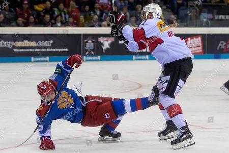 Russia's Artyom Manukyan (L) fights for the puck against Switzerland's Richard Tanner during the Ice Hockey Deutschland Cup match between Switzerland and Russia at the Koenig Palast stadium in Krefeld, Germany, 11 November 2018.