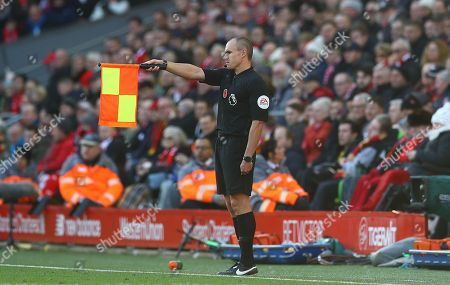 Assistant referee Adrian Holmes signals for a decision, earlier in the match he ruled Aleksander Mitrovic of Fulham offside as he thought he had scored the first goal