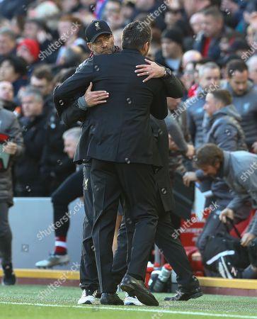 Liverpool manager Jurgen Klopp hugs Fulham manager Slavisa Jokanovic at full time