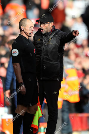 Liverpool Manager Jurgen Klopp speaks with assistant referee Adrian Holmes immediately after Liverpool score their opening goal 14 seconds after he had disallowed a goal by Aleksander Mitrovic of Fulham