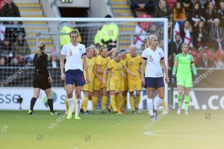 Jill Scott of England and Stephanie Houghton of England look dejected after the 2nd goal.