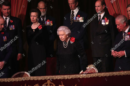 Queen Elizabeth II with Princess Anne, Prince Michael of Kent, Prince Edward and Prince Charles attend the Royal British Legion Festival of Remembrance at the Royal Albert Hall