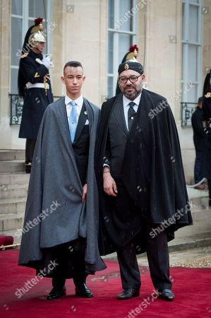 King Mohammed VI of Morocco (R) and his son the Prince Hassan bin Talal leave the Elysee palace