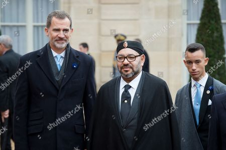 Spain's King Felipe VI, King Mohammed VI of Morocco (R) and his son the Prince Hassan bin Talal as they arrive to attend a lunch at the Elysee Palace