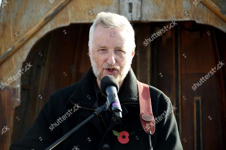 Stock Picture of Billy Bragg reads a poem by Carol Ann Duffy written to mark the centenary of Armistice Day called The Wound in Time as part of Pages of the Sea, Weymouth, Dorset, UK