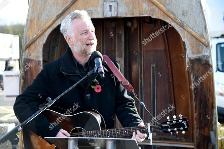 Stock Image of Billy Bragg reads a poem by Carol Ann Duffy written to mark the centenary of Armistice Day called The Wound in Time as part of Pages of the Sea, Weymouth, Dorset, UK