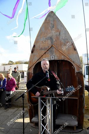 Billy Bragg reads a poem by Carol Ann Duffy written to mark the centenary of Armistice Day called The Wound in Time as part of Pages of the Sea, Weymouth, Dorset, UK