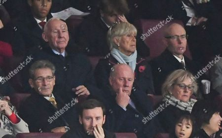 Former Arsenal players Bob Wilson and Liam Brady look on from the Directors' Box