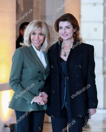 Ukrainian President Petro Poroshenko's wife Maryna Poroshenko (R) is welcomed by French First Lady Brigitte Macron (L) for a partners' lunch on the side of the international ceremony for the Centenary of the WWI Armistice of 11 November 1918 in Versailles Castle in Versailles, France, 11 November 2018. World leaders have gathered in France to mark the 100th anniversary of the First World War Armistice with services taking place across the world to commemorate the occasion.
