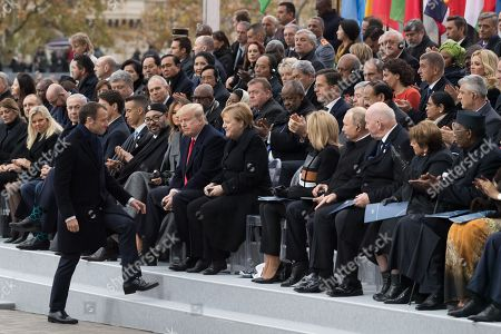 Emmanuel Macron, Prime Minister of Israel, Benjamin Netanyahu and his wife, Prime Minister of Canada Justin Trudeau, Morocco's King Mohammed VI and his son, first lady Melania Trump, U.S. President Donald Trump, German Chancellor Angela Merkel and Brigitte Trogneux, Vladimir Putin and Australian Governor-General Sir Peter Cosgrove.