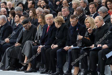 Morocco's King Mohammed VI and his son, first lady Melania Trump, U.S. President Donald Trump, German Chancellor Angela Merkel, Emmanuel Macron and Brigitte Trogneux, Russian President Vladimir Putin and Australian Governor-General Sir Peter Cosgrove.