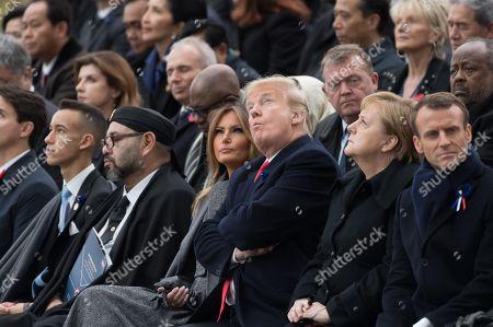 Morocco's King Mohammed VI and his son, first lady Melania Trump, U.S. President Donald Trump, German Chancellor Angela Merkel, Emmanuel Macron.