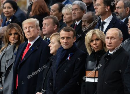 First lady Melania Trump, U.S. President Donald Trump, German Chancellor Angela Merkel, French President Emmanuel Macron and Brigitte Trogneux and Russian President Vladimir Putin.  French President Emmanuel Macron and Brigitte Trogneux, German Chancellor Angela Merkel, U.S. President Donald Trump, first lady Melania Trump, Morocco's King Mohammed VI, Russian President Vladimir Putin, Australian Governor-General Sir Peter Cosgrove attend a commemoration ceremony for Armistice Day, 100 years after the end of the First World War at the Arc de Triomphe.