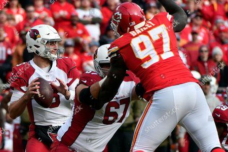 Arizona Cardinals quarterback Josh Rosen (3) looks to throw as offensive guard Justin Pugh (67) blocks Kansas City Chiefs defensive lineman Allen Bailey (97) during the first half of an NFL football game in Kansas City, Mo