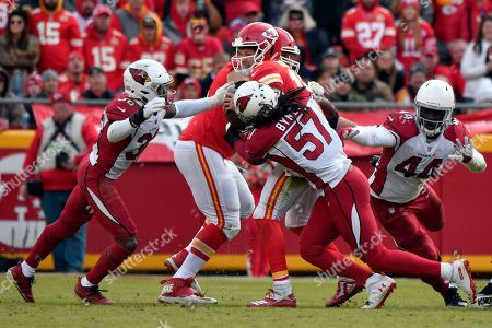 Kansas City Chiefs quarterback Patrick Mahomes, center, is sacked by Arizona Cardinals safety Budda Baker (36), linebacker Josh Bynes (57) and defensive end Markus Golden (44) during the second half of an NFL football game in Kansas City, Mo