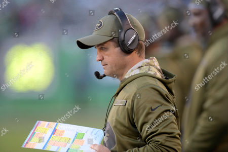 Stock Image of New York Jets offensive coordinator Jeremy Bates looks at charts during the second half of an NFL football game against the Buffalo Bills, in East Rutherford, N.J