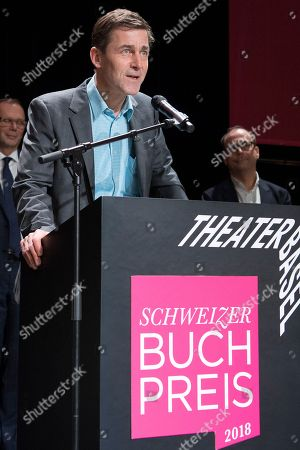 Stock Picture of Swiss writer Peter Stamm delivers a speech at the Swiss Book Prize ceremony after receiving the award for his book 'Die sanfte Gleichgueltigkeit der Welt' (The gentle indifference of the world) at the Theater Basel, in Basel, Switzerland, 11 November 2018.