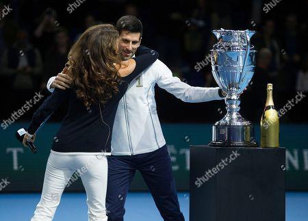 Novak Djokovic (SRB) receives a hug from Ex British No1 tennis player Annabel Croft