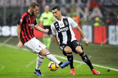 AC Milan's Ignazio Abate, left, and Juventus' Cristiano Ronaldo fight for the ball during a Serie A soccer match between AC Milan and Juventus, at Milan's San Siro stadium