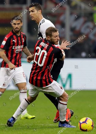 Juventus' Cristiano Ronaldo, top, and AC Milan's Ignazio Abate fight for the ball during a Serie A soccer match between AC Milan and Juventus, at Milan's San Siro stadium