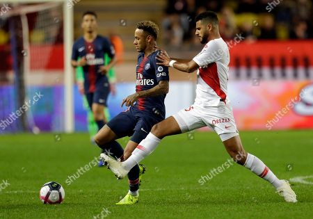 PSG's Neymar, left, battles for the ball with Monaco's Youssef Ait-Bennasser during the French League One soccer match between AS Monaco and Paris Saint-Germain at Stade Louis II in Monaco